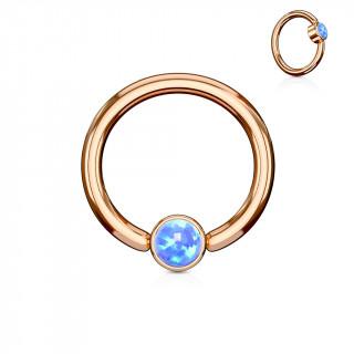Anneau cuivré à cylindre captif serti d'une opale bleue