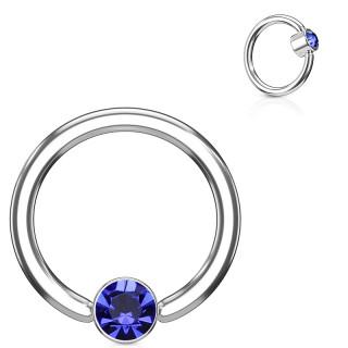 Anneau à cylindre captif serti d'un cristal bleu