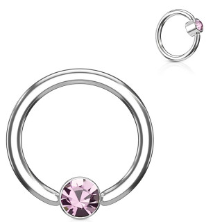 Anneau à cylindre captif serti d'un cristal rose