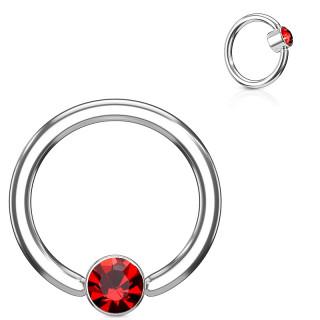 Anneau à cylindre captif serti d'un cristal rouge