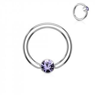 Anneau à cylindre captif serti d'un cristal violet tanzanite