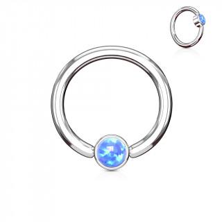Anneau à cylindre captif serti d'une opale bleue