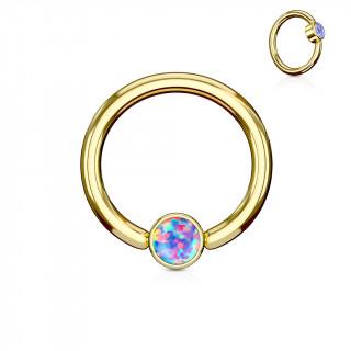 Anneau doré à cylindre captif serti d'une opale violette