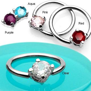 Piercing anneau captif serti d'une pierre ronde