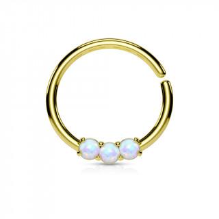 Piercing anneau doré serti de 3 opales claires