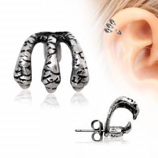 Piercing cartilage hélix à griffes de dragon