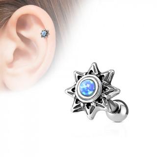 Piercing cartilage soleil tribal à Opale bleue