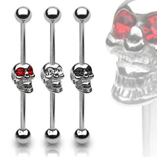 Piercing industriel avec tête de mort aux yeux de pierre